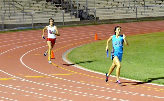 Seabury Hall's Dakota Grossman makes her move in the girls 4x400 relay. Photo by Rodney S. Yap.
