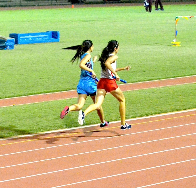 Grossman makes her final kick down the stretch of the girls 4x400 relay. Photo by Rodney S. Yap.