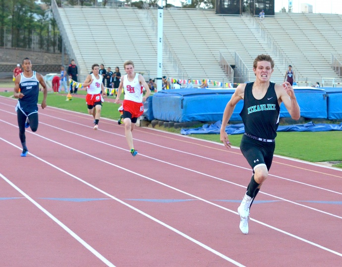 King Kekaulike's Jake Jacobs en route to a record-breaking performance in the boys 400-meter dash Saturday. Photo by Rodney S. Yap.