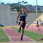 King Kekaulike's Jansen Agapay en route to his record-breaking long jump of 23 feet, 3.25 inches, at Friday's MIL Track and Field Championship Trials. Photo by Rodney S. Yap.