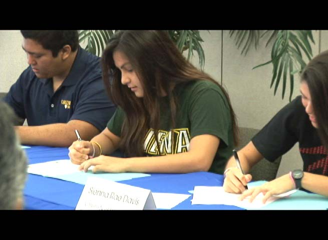 Bobbi Lin Kalama, center, signs a letter of intent with Siena College, where she was offered a full-ride scholarship. Photo by Wendy Osher.