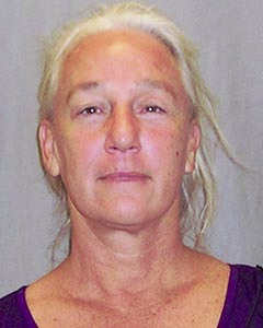 Katherine Hunter, above, is wanted in connection with a custodial interference case involving her grandson. HPD photo.