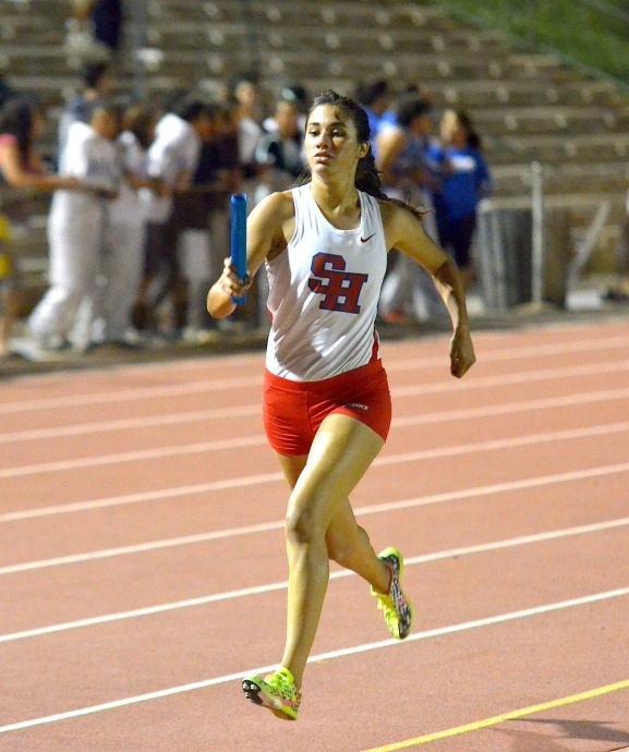 Seabury Hall's Kiana Smith in the girls 4x400 relay that was disqualified Saturday after unofficially breaking the meet record. Photo by Rodney S. Yap.