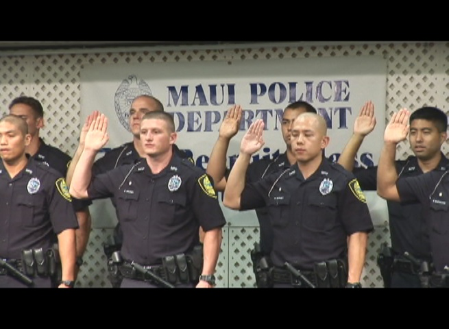Members of the Maui Police Department's 77th Recruit Class take the officer's oath during graduation. Photo by Wendy Osher.