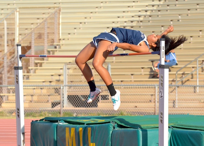 Kamehameha Maui's Raven Poepoe clears 5 feet, 2 inches in the girls high jump. Photo by Rodney S. Yap.