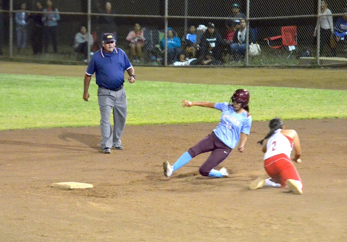 Baldwin's Alysha Sakamura gets around the tag of Lahainaluna shortstop  . Photo by Rodney S. Yap.