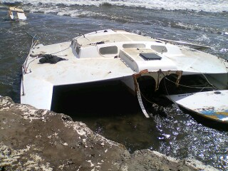"38' trimaran ""Triple Play"" also aground at the Mala shoreline.  This vessel does not have insurance. Staff are working to obtain a bid for emergency salvage removal of the vessel.  Photos courtesy DLNR Maui district boating office."