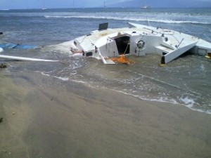 """30' sailing vessel """"Caribou III"""" -- most of the broken pieces were quickly removed except for the mast and the mooring gear (ball and chain) which will be removed by Parker Marine when the surf subsides. The beach area is now clear.  Photo courtesy Maui District Boating Office."""