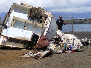 Best Revenge debris prepared for removal to central Maui landfill.  Ed Underwood, DOBOR administrator inspects the debris pile. Photo courtesy Maui district boating office.