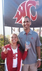 Kristine Felix holds her first-place award with Cougars' pole vault coach Matt McGee. Photo by Washington State Athletics.