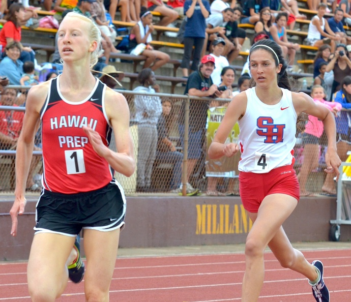 Hawaii Preparatory Academy's Zoe Sims pulls away from Seabury Hall's Dakota Grossman down the final stretch of their 3,000-meter run Saturday at Mililani High School. Both runners broke the meet record of 4:38.83 set in 1999 by Punahou's Victoria Chang. Sims was awarded the gold medal in 4:36.22 and Grossman the silver in 4:37.23. Photo by Rodney S. Yap.