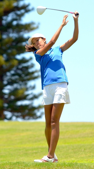 Moanalua's Eimi Koga watches her drive at No. 14. Koga finished ninth overall at 78-77—155. Photo by Rodney S. Yap.
