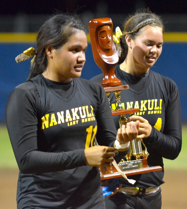 Nanakuli's Ashley Van Gieson (right) and Brayann Meyers hold the girls Division II state softball championship trophy following their 5-4 win over Saint Francis on Friday at the Patsy Mink Field. Photo by Rodney S. Yap.