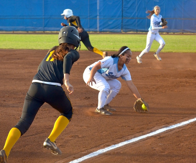Saint Francis first baseman Rasela Vili makes a play on a ground ball hit by Brayann Meyers in the second inning of the girls Division II state softball championships at Patsy Mink Field. Photo by Rodney S. Yap.