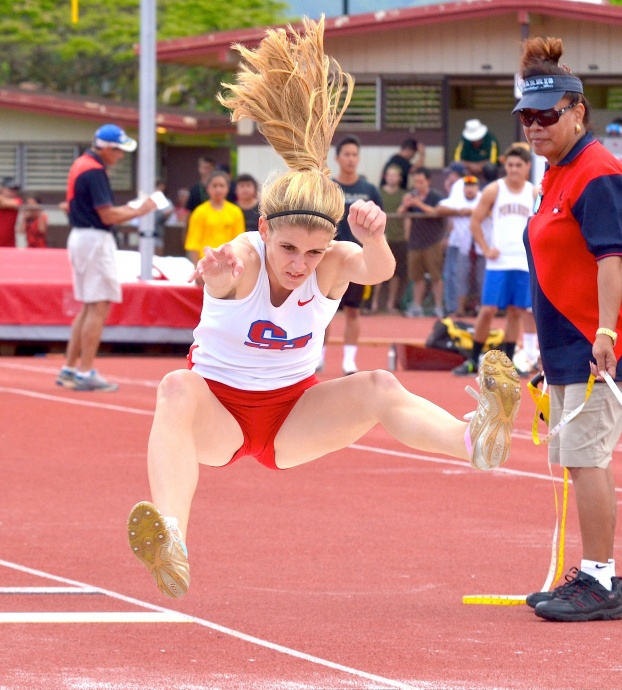 Seabury Hall's Alyssa Bettendorf was busy running the 100 (3rd), 200 (3rd), 400 (2nd) and jumping. The Spartan junior placed third in the long jump at 16 feet, 7 inches. Photo by Rodney S. Yap.