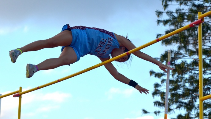 Baldwin's Amber Kozaki sets a new state record in the girls pole vault at 13 feet. Photo by Rodney S. Yap.