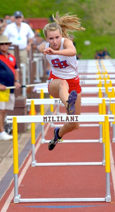Seabury Hall's Christy Fell in the 100-meter high hurdles Saturday. Photo by Rodney S. Yap.