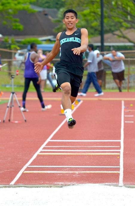 Jansen Agapay of King Kekaulike won the boys long jump in 22 feet, 11.25 inches, and he finished fourth in the triple jump in 44-01. Photo by Rodney S. Yap.