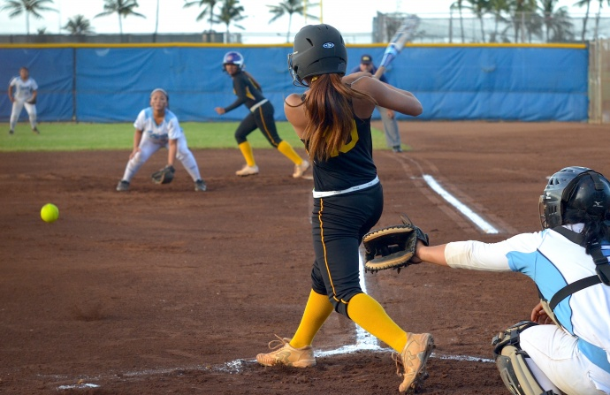Nanakuli pitcher Chyanne Koko hits as RBI single to right field in the first inning against Saint Francis Friday at the state Division II girls softball tournament at Patsy Mink Field. Koko's hit helped the Golden Eagles grab a 1-0 lead. Photo by Rodney S. Yap.
