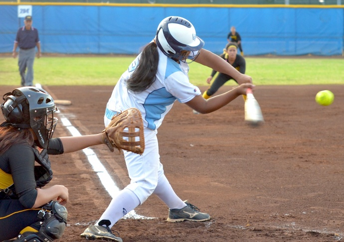 Saint Francis Rachel Carlos gets on base via a fielding error at shortstop following this hit in the first inning Friday. Photo by Rodney S. Yap.