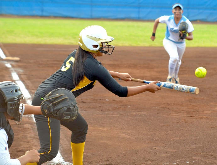 Nanakuli's Keanani Chai (5) puts down a sacrifice bunt in the second inning. Photo by Rodney S. Yap.