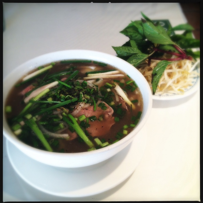 Saigon Seafood's Pho arrives with a solid pound of Thai basil. Photo by Vanessa Wolf