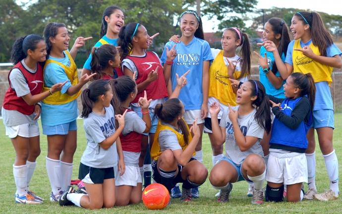 Ilihia Keawekane (middle) is the center of attention on the '00 Pono SC after becoming Maui's first female soccer player to be invited to train with the U14 United States Women's National Soccer Team. Front Row (left to right), Breanne Mukai, Tehani Moikeha, Darian Fernandez, Shayna Yoshida, Kaeana Anguay. Second row (left to right), Tihanee Freitas, Mikayla Barut, Makamae Aquino, Chai Cortez, Ilihia Keawekane, Kamalei Roback, Kainoa Dafun, Leialoha Medeiros and Kylee Yamashita (back). Photo by Rodney S. Yap.