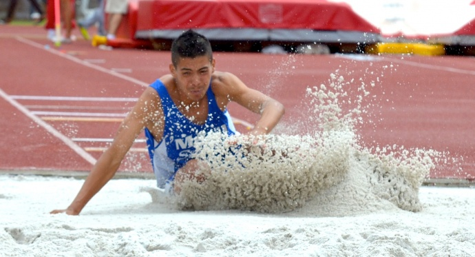 Maui High's Raymond Ledesma placed fourth in the boys long jump at 21 feet, .75 inches. Photo by Rodney S. Yap.