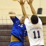 Maui High's Sage Malaikini pounds a kill shot past the block of Kamehameha Maui's Kolby AhSau during Wednesday's semifinal match at Baldwin Gym. Photo by Rodney S. Yap.
