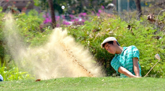 Mid-Pacific golfer Skye Inakoshi uses his sand wedge out of the bunker at No. 14 Wednesday at the Royal Kaanapali Golf Course. Inakoshi placed third in the boys individual scoring with a 36-hole total of 68—75—143. Photo by Rodney S. Yap.