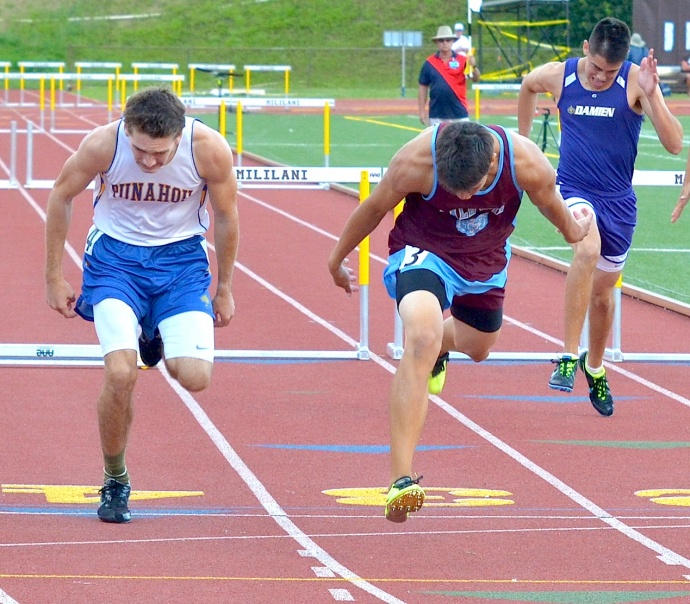 Baldwin's Tyler Feiteira leans at the finish line of the 300-intermediate hurdles in front of Punahou's Griffin Saunders. Feiteira won the race in 40.03 seconds. Photo by Rodney S. Yap.