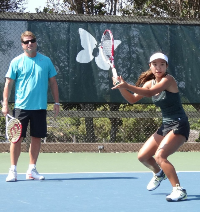 Maui Preparatory Academy's incoming freshman Jaylee Yasunaga at a recent tennis practice in Kapalua with coach John Evert of Evert Tennis Academy. Photo by k3MarketingGroup.com.