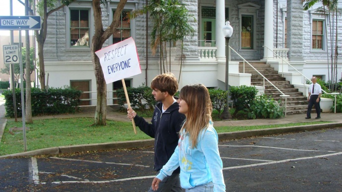 Unnamed individuals carrying signs during a Martin Luther King Jr. march on Maui two years ago. File photo 2011 by Wendy Osher. Note: The complaint was filed in reference to the December 2012 event, which occurred along the same route the following year.
