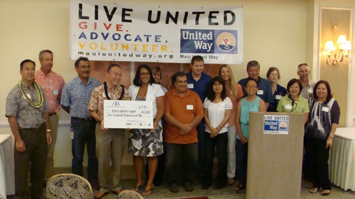 A&B's Grant Chun presents a $100,000 check to Maui United Way president Laksmi Abraham. Photo by Wendy Osher.