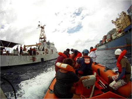 Coast Guardsmen aboard a small boat from the 110-foot Coast Guard Cutter Washington assist in transferring 10 canoeists, who were saved by the cargo vessel Hyundai Unity, March 4, 2013, approximately 103 miles off the coast of Palau. The Coast Guard, in coordination with the Republic of Palau Division of Maritime Law Enforcement and the Royal Australian Navy Maritime Surveillance Adviser, partnered to provide assistance to the Republic of Palau in the rescue of the 10 mariners from the Philippine Sea. (US Coast Guard photo) Read more: http://www.dvidshub.net/image/879249/coast-guard-cutter-washington-assists-passenger-transfer#.Uec2HdjYHeU#ixzz2ZLu0HFEj