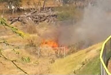A rush fire was reported on Tuesday afternoon, July 9, 2013 near Leleihoku Street in Wailuku, just outside of the Baldwin HS baseball field. Photo courtesy Robert.