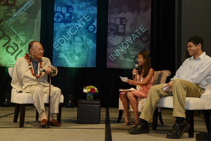 The late Hawaii US Sen. Daniel Inouye chatted with MC's Lindzi Takasaki and Bryce Ribucan on stage during last year's MEDB Ke Alahele Education Fund dinner. Courtesy photo.