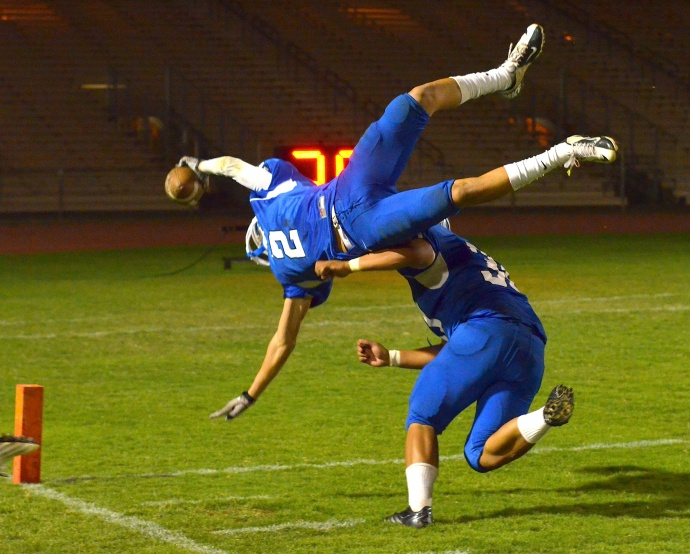 Maui High's Andre Pierman (2) launches into the end zone following his second interception Saturday against Konawaena. Photo by Rodney S. Yap.