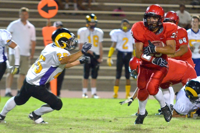Lahainaluna's Jared Rocha-Islas added 87 yards on seven carries sharing the rushing load. Photo by Rodney S. Yap.