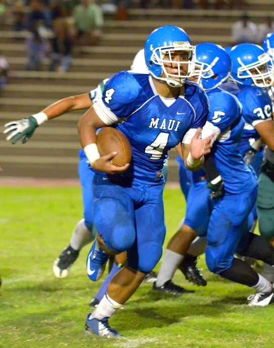 Maui High's Onosai Emelio (4) scores the second of his three touchdowns Saturday against Konawaena at War Memorial Stadium. Photo by Rodney S. Yap.