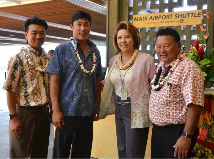 Attendees at the blessing of Roberts Hawaiʻi's Maui Airport Shuttle service included (from left): Lt. Governor Shan Tsutsui; Chad Iwamoto, VP Roberts Hawaiʻi; Tina Yamaki, Director of Sales, Roberts Hawaiʻi; and Maui Mayor Alan Arakawa. Photo courtesy Luly Unemori.