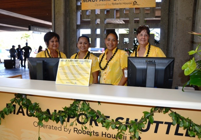 Maui Airport Shuttle employees (from left): Karen Fujimoto, Mary Ann Tamashiro, Cypress Kamaunu, and Carol West were among the Roberts Hawaiʻi employees working the first day of service on Aug. 1, 2013.