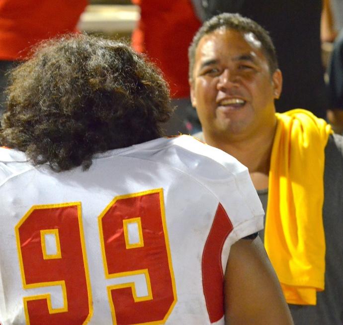 Mission Viejo defensive tackle Neff Haleakala finds his dad, Valentine Haleakala Jr., after Friday's game against Baldwin at War Memorial Stadium.  Photo by Rodney S. Yap.