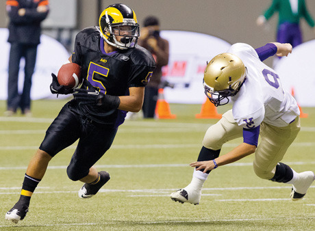 Marcus Davis returns a punt 65 yards for a touchdown in the first quarter as the Mount Douglas Rams surged ahead of the Vancouver College Fighting Irish in the Subway Bowl, AAA high school football provincial championship, at B.C. Place on Saturday (Dec. 1).  The Rams powered their way to a 51-14 victory. Photo by Christian J. Stewart Photography.