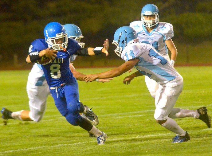 Maui High quarterback Tyson Takabayashi (8) stiff arms Saint Francis' defender  Devin Ibous during first-half action Friday at War Memorial Stadium. Photo by Rodney S. Yap.