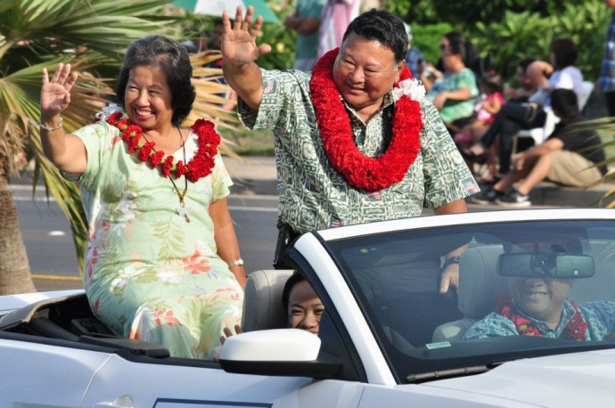 Mayor Arakawa and wife waving to the crowd at last year's Maui Fair Parade. File photo by Kit Zulueta, Sept. 2012, courtesy County of Maui facebook.