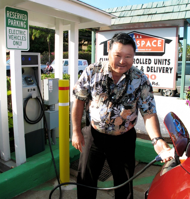 """""""As EV chargers become more available across the island, electric vehicles become more appealing as an alternative to gasoline powered cars,"""" said Mayor Arakawa during the March 2012 dedication of an electric vehicle charging station at the AAAAA Rent-A-Space center in West Maui. File photo courtesy Gilbert Advertising."""