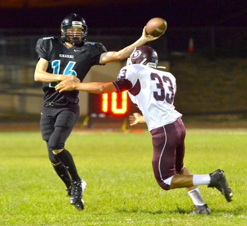 King Kekaulike quarterback Ryley Widell tries to deliver this pass as Baldwin's Chase Kuluhiwa-Rodrigues applies defensive pressure. Photo by Rodney S. Yap.