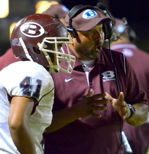 Baldwin head coach Keneke Pacheco explains a penalty call to Titus Asis (41) during fourth-quarter action Saturday at King Kekaulike Stadium. Photo by Rodney S. Yap.
