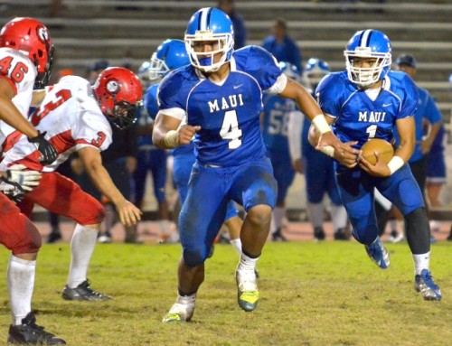 Maui High's Soane Vaohea (1) follows the lead block of Onosai Emelio (4) during second-half action Friday at War Memorial Stadium. Photo by Rodney S. Yap.